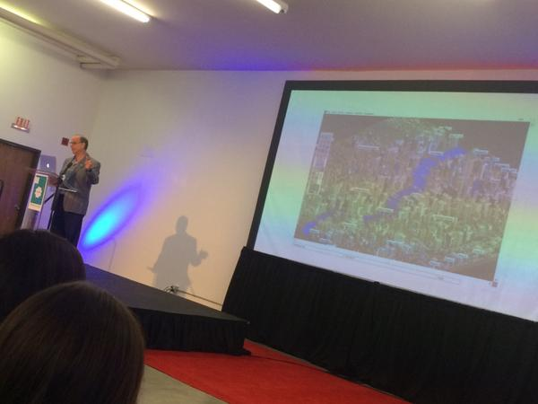 Not the best photo, but it's David Weinberger with an image of Sim City behind him so that's pretty awesome.